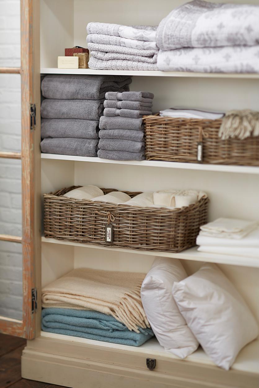 como organizar roupa de cama